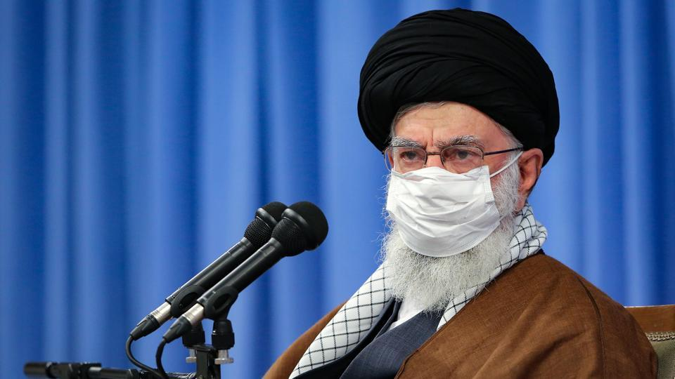 In this picture released by the official website of the office of the Iranian supreme leader, Supreme Leader Ayatollah Ali Khamenei, wearing a mask to protect against Covid-19, attends a meeting with National Corona Headquarters, in Tehran, Iran.