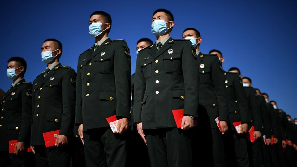 Paramilitary police officers stand in formation outside the Great Hall of the People in Beijing, China on October 23. Asia crossed 10 million infections of the coronavirus on October 24, accounting now for the second-heaviest regional toll in the world, according to a Reuters tally based on official reporting of cases by countries. (Noel Celis / AFP)