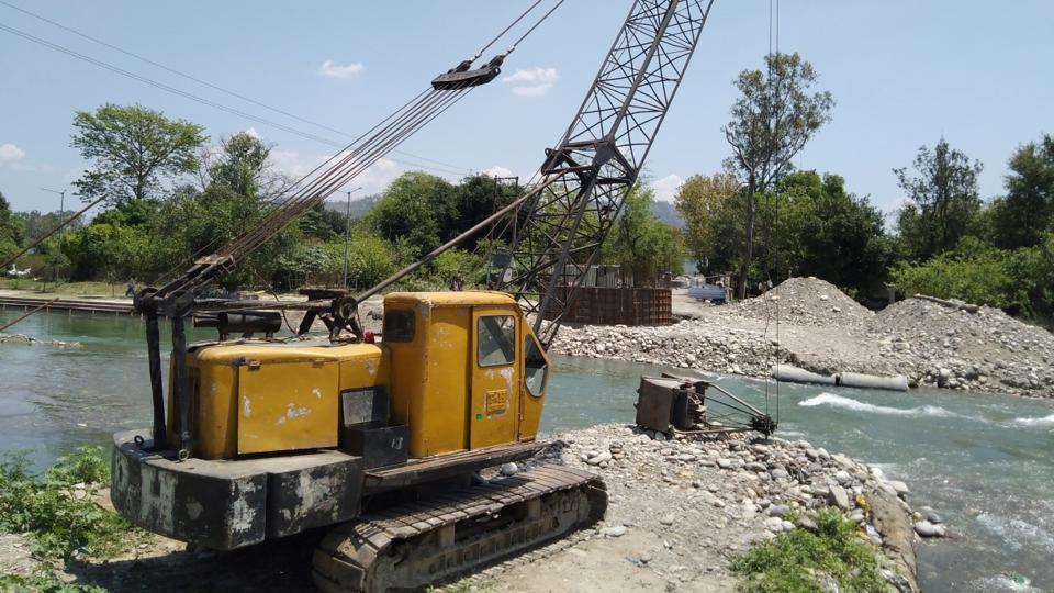 Work for the Kumbh Mela underway at a bridge site in Kankhal, Haridwar.