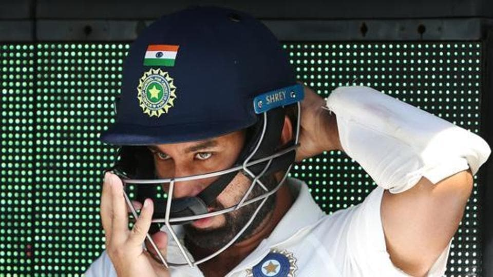 Cheteshwar Pujara of India walks out to bat during day two of the Third Test match in the series between Australia and India at Melbourne Cricket Ground.