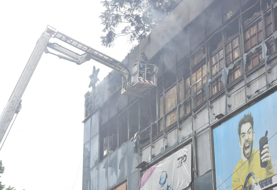 Fire Brigade personnel trying to douse the fire at City Centre Mall, Bombay Central on the second day in Mumbai on Saturday.