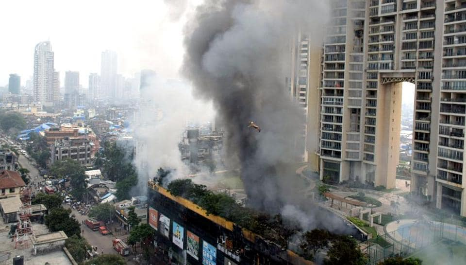 Smoke billows out from the fire broke out at City Center mall in Mumbai on Thursday.