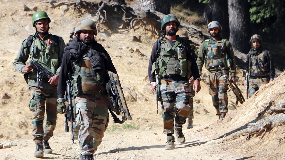 Army personnel rush towards an encounter site in Srinagar.