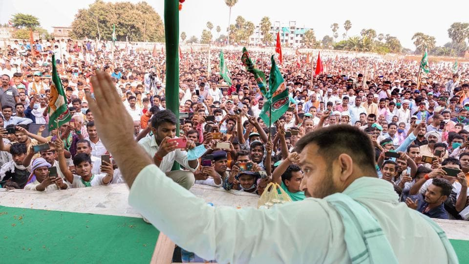 RJD leader Tejashwi Prasad Yadav addresses a gathering during an election rally for the upcoming Bihar assembly elections.