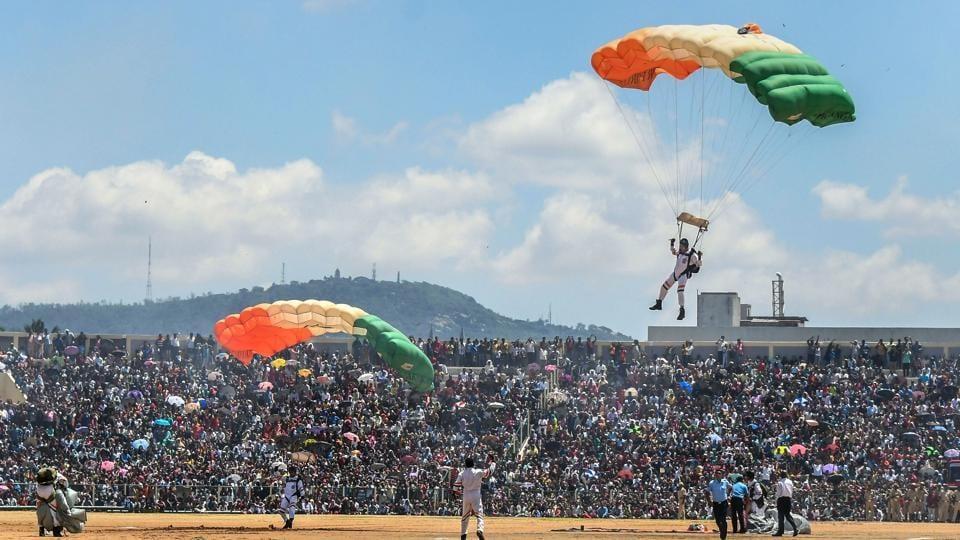 Akash Ganga, the skydiving team of the Indian Air Force (IAF), perform during Dasara Air Show at Bannimantap Grounds, in Mysuru, last year.