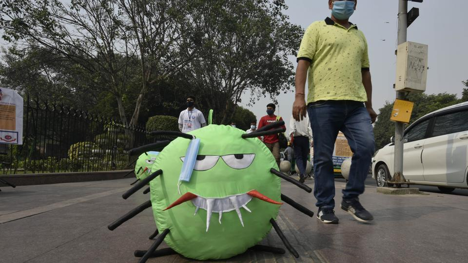 A mascot newly launched by Delhi administration to raise awareness against rising air pollution and Covid-19 cases, at Connaught Place Inner Circle, in New Delhi.