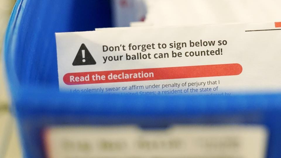 There were 122 ballots inside the box when it was emptied Sunday morning, and 87 of them were still legible and able to be processed, Galvin's office said.