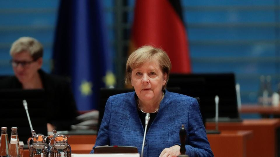FILE PHOTO: German Chancellor Angela Merkel attends the weekly cabinet meeting of the government at the chancellery in Berlin, Germany October 21, 2020. Markus Schreiber/Pool via REUTERS/File Photo