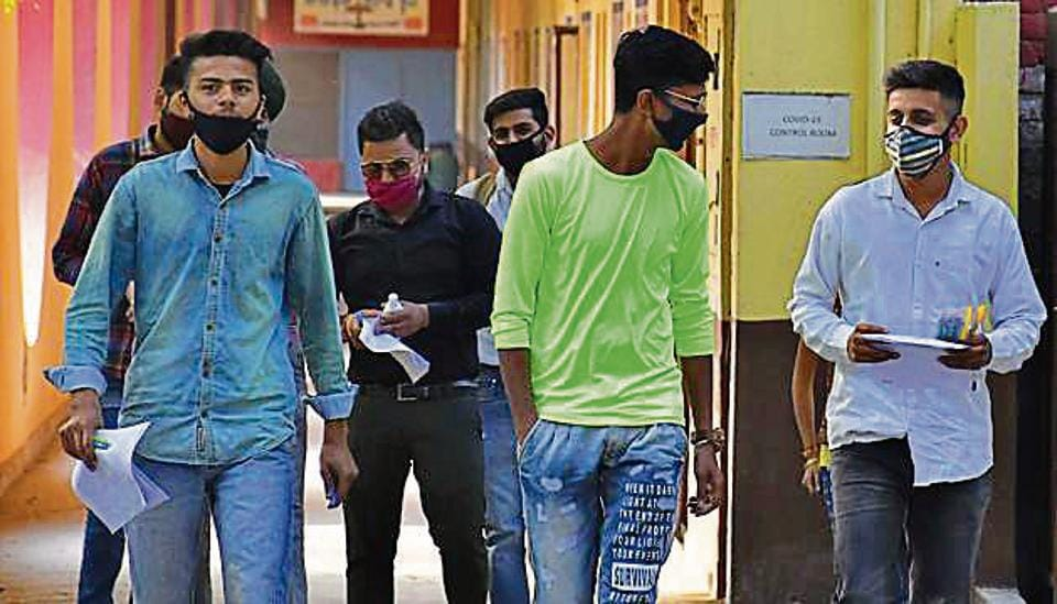 Students coming out of the exam centre at the Bharat Nagar Chowk government school on Monday.
