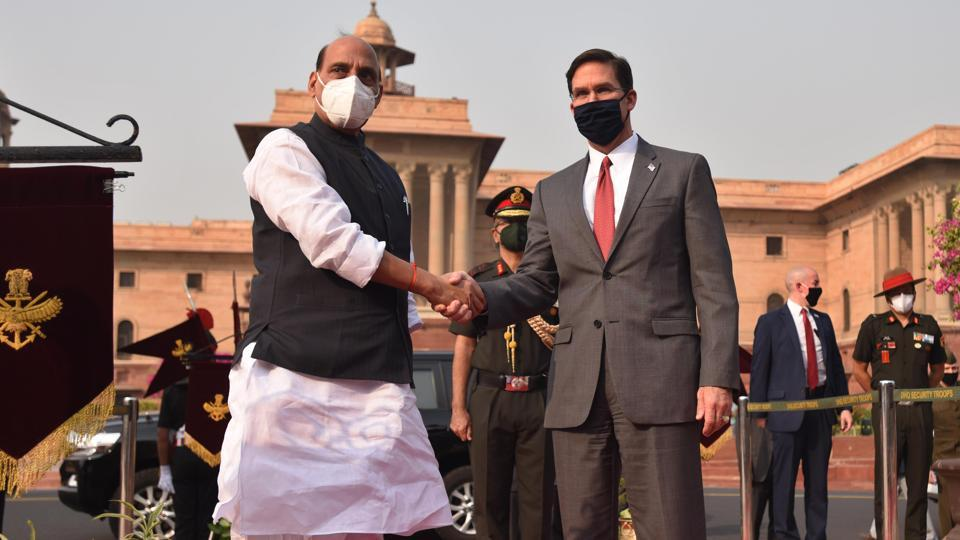 Defence minister Rajnath Singh welcomes US secretary of defence Mark Esper to a tri-services Guard of Honour at South Block Lawns.