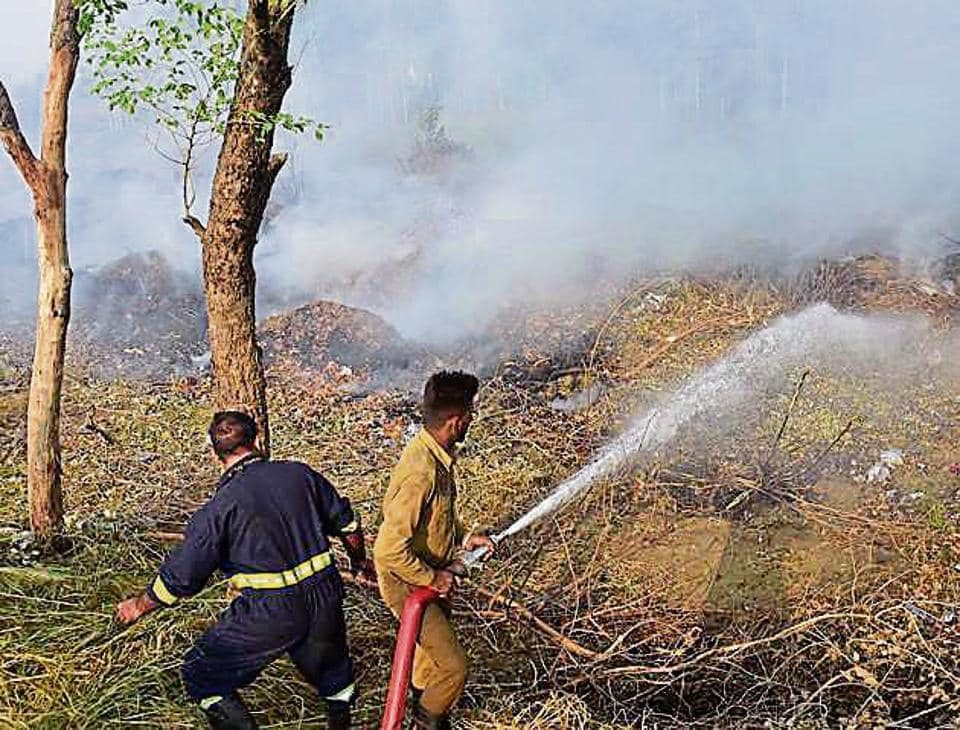 Firefighters trying to control the blaze at the garbage dump on PAU campus in Ludhiana on Monday.