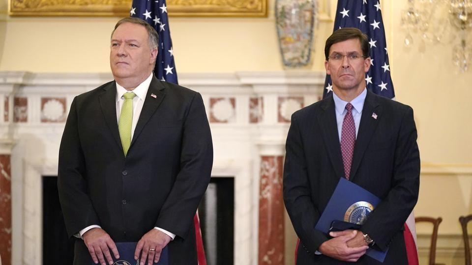 In picture - Secretary of State Mike Pompeo and Defense Secretary Mark Esper attend a news conference at the US State Department in Washington.