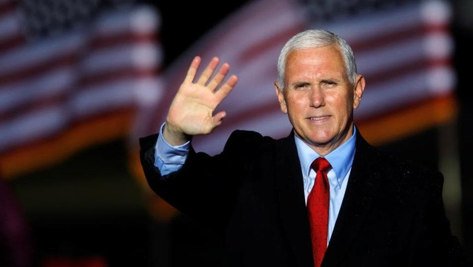 US Vice President Mike Pence waves to supporters at the end of a rally in Kinston, North Carolina.