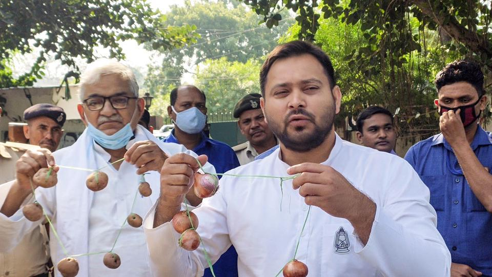 RJD leaderTejashwi Yadav holds an onion garland during a protest over hike in the prices of the vegetable, in Patna on October 26.