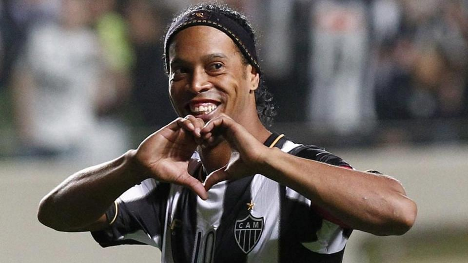 Brazil's Atletico Mineiro's Ronaldinho celebrates his team's victory over Argentina's Newell's Old Boys at the end of a Copa Libertadores semifinal soccer match in Belo Horizonte, Brazil.
