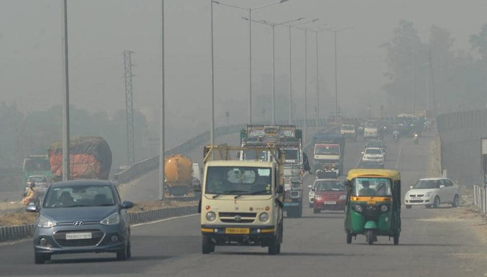Vehicles ply on Jalandhar-New Delhi National Highway, amid hazy weather conditions,  on October 24.