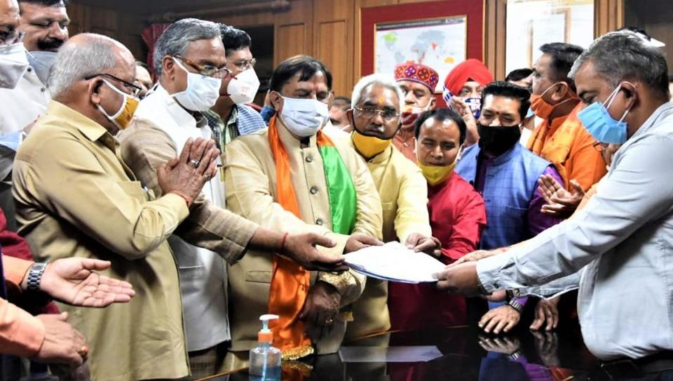 Uttarakhand BJP leader Naresh Bansal filing his nomination papers for a Rajya Sabha seat from Uttarakhand in the presence of chief minister Trivendra Singh Rawat and senior party leaders.