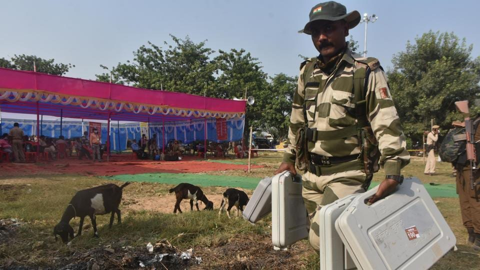 Security personnel seen carrying EVM machines on the eve of the first phase of Bihar Assembly election.