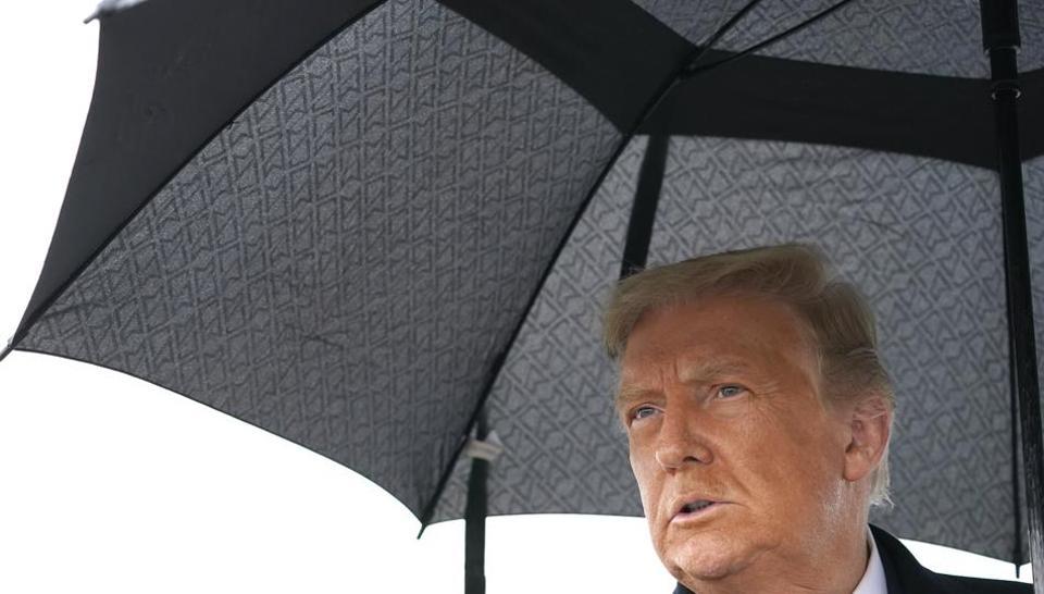 US President Donald Trump speaks to the media on arrival, Monday, Oct. 26, 2020, in Allentown, Pennsylvania (AP Photo/Alex Brandon)
