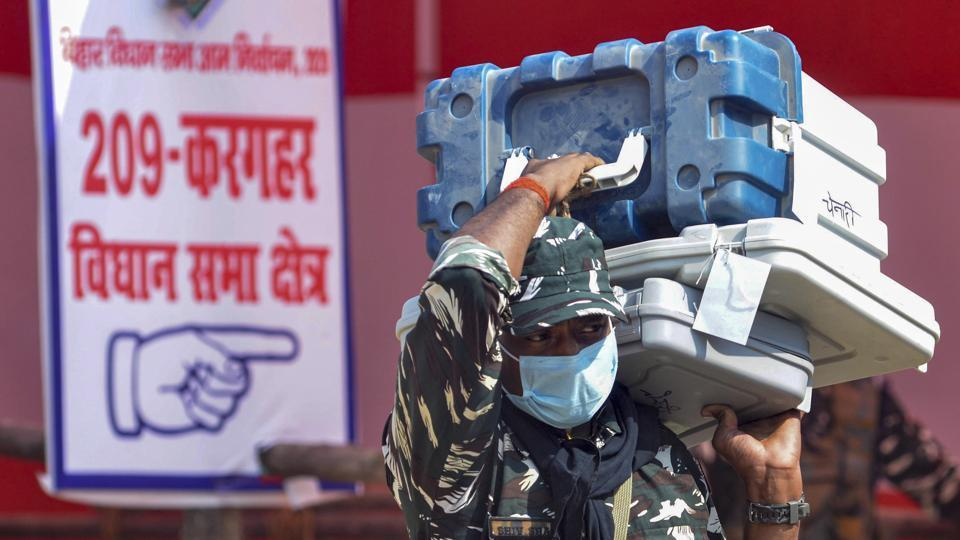 Security personnel carrying Electronic Voting Machines (EVMs) arrive on the eve of first phase of Bihar Assembly Election.