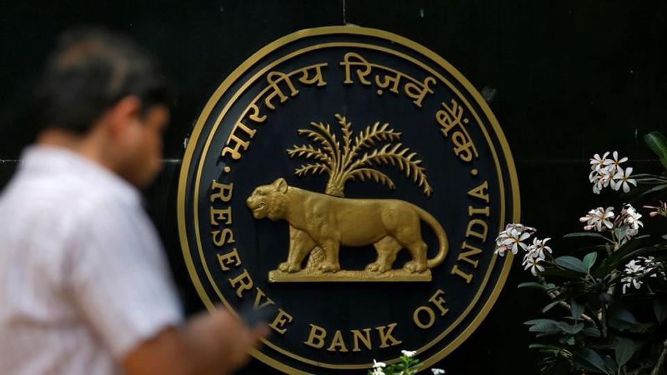 A man checks his phone outside the Reserve Bank of India (RBI) headquarters in Mumbai.