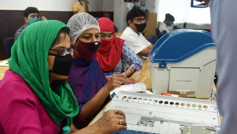 Women looking Electronic Voting Machine (EVM) and Voter-Verified Paper Audit Trail (VVPAT) during a training programme of Sub-Divisional officers (SDO) ahead of Bihar assembly polls.