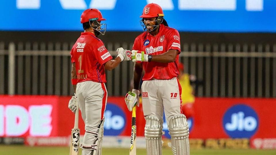 Kings XI Punjab batsmen Chris Gayle and KL Rahul during the Indian Premier League (IPL) cricket match against Royal Challengers Bangalore, at Sharjah Cricket Stadium, in Sharjah.