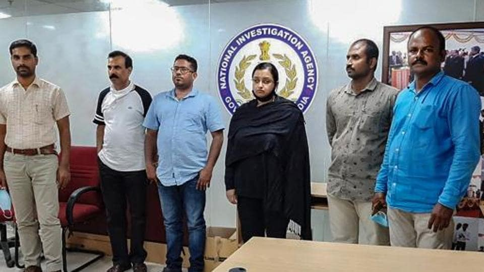 Kerala gold smuggling case accused Swapna Suresh and Sandeep Nair (both in middle) were arrested by the National Investigation Agency in Bengaluru earlier this year for their involvement in the smuggling racket.