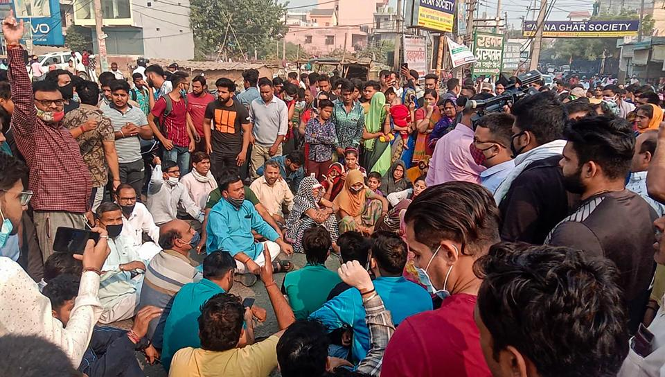 Family members of a college student, who was allegedly shot dead outside her college, block the Ballabhgarh-Sohna road during a protest demanding justice for her.