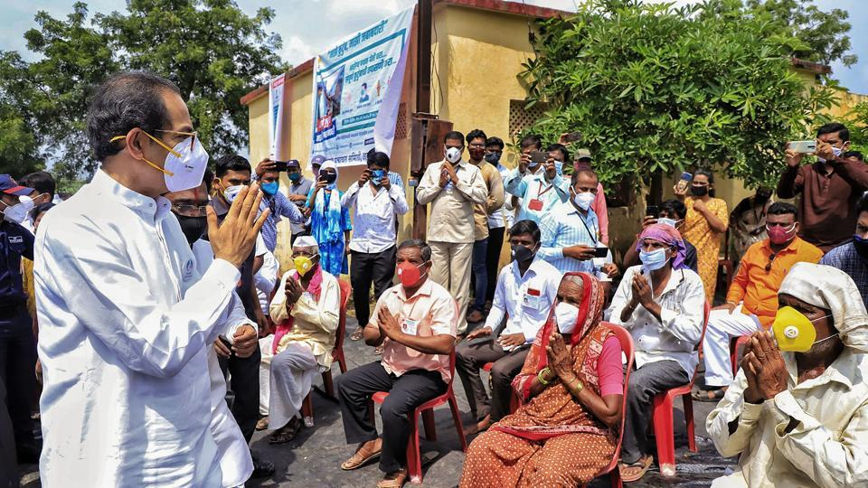 Maharashtra Chief Minister Uddhav Thackeray interacts with the affected farmers during a visit to unseasonal rain-hit areas in Akkalkot taluka in Solapur.