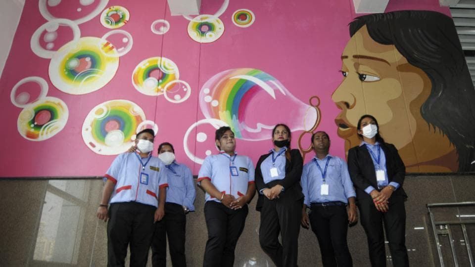 Employees at Noida Metro Rail Corporation's (NMRC) Pride Station dedicated to the Transgender community, at Sector 50, in Noida.