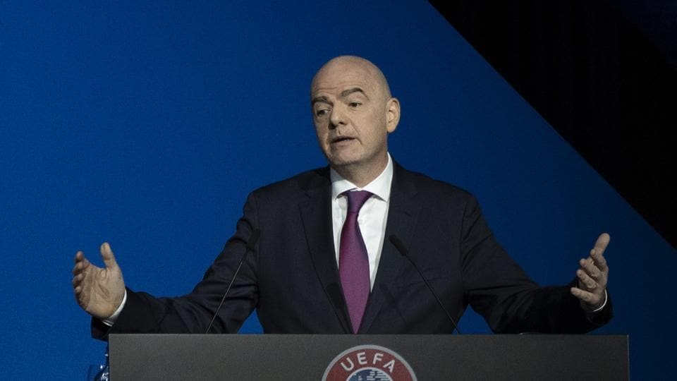 """FILE - In this file photo dated Tuesday, March 3, 2020, FIFA President Gianni Infantino addresses a meeting of European soccer leaders at the congress of the UEFA governing body in Amsterdam, Netherlands. Infantino has tested positive for COVID-19, and according to a statement FIFA says Infantino """"has reported mild symptoms, has immediately placed himself in self-isolation and will remain in quarantine at least for ten days."""" (AP Photo/Peter Dejong, FILE)"""