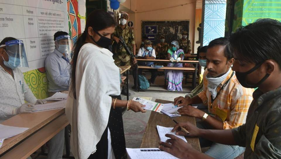 A voter presents identification documents during voting for Bihar Legislative Council elections at a polling centre at Miller High School in Patna, Bihar.