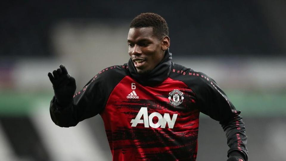 FILE PHOTO: Soccer Football - Premier League - Newcastle United v Manchester United - St James' Park, Newcastle, Britain - October 17, 2020 Manchester United's Paul Pogba warms up before the match Pool via REUTERS/Alex Pantling/File Photo