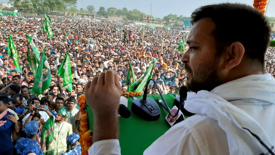RJD leader Tejashwi Yadav addresses an election meeting on upcoming Bihar Assembly polls in Bhagalpur district.