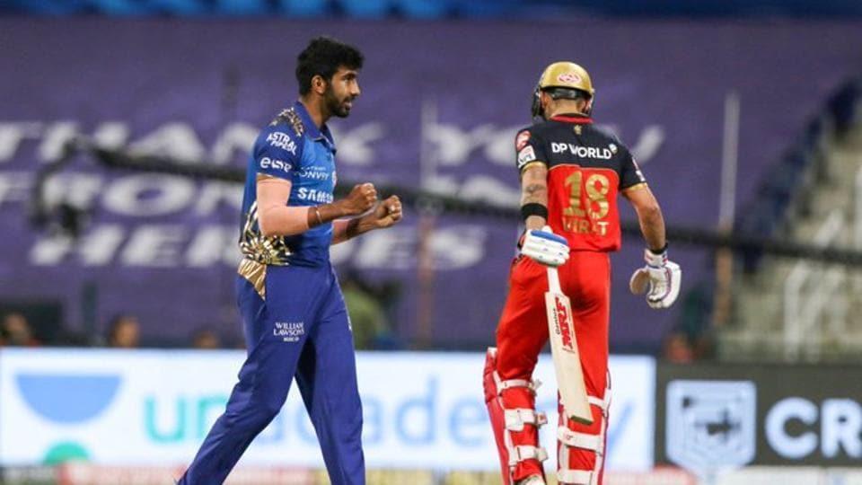 Mumbai Indians pacer Jasprit Bumrah picks up the wickets of RCB captain Virat Kohli, his 100th in IPL career.