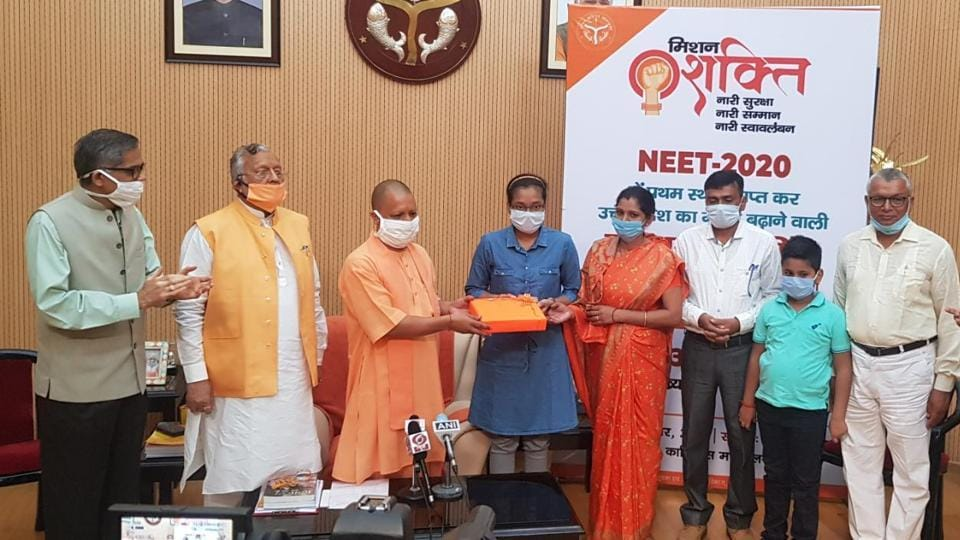 Chief minister Yogi Adityanath felicitating Akanksha Singh in the presence of her family members as well as medical education minister Suresh Khanna and chief secretary RK Tiwari on Wednesday.