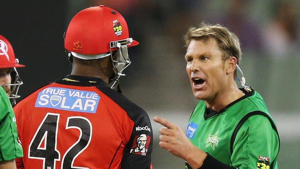 Shane Warne (R) of the Melbourne Stars has a heated exchange with Marlon Samuels of the Melbourne Renegades during the Big Bash League match between the Melbourne Stars and the Melbourne Renegades at Melbourne Cricket Ground on January 6, 2013.