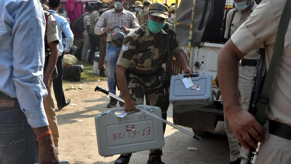 The Election Commission has notified strict guidelines for distancing, mask wearing and temperature checks, and procured thousands of personal protective equipment and Covid gear. (Photo by Parwaz Khan/Hindustan Times)