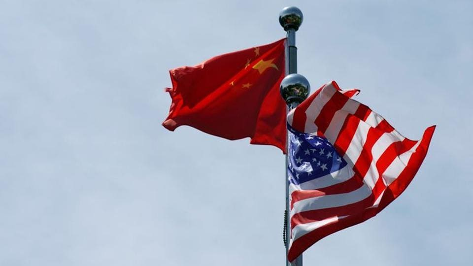 Chinese and US flags flutter near The Bund, before US trade delegation meet their Chinese counterparts for talks in Shanghai, China.
