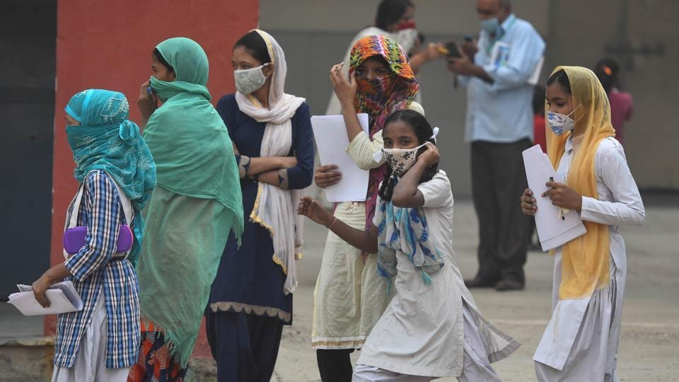 School students coming out of their school after getting worksheets as schools in Delhi are closed due to Covid-19 pandemic in in New Delhi on October 28, 2020.