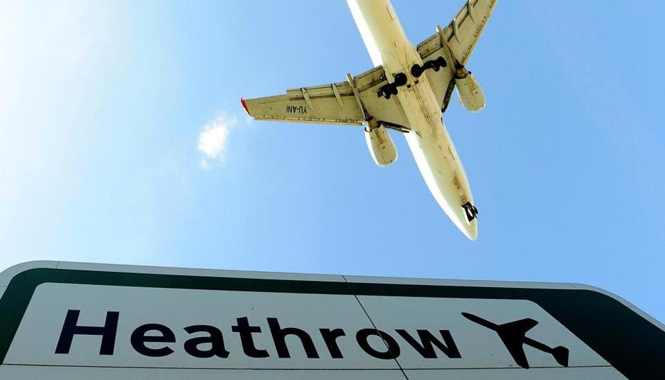 An aircraft comes in to land at Heathrow Airport in west London .