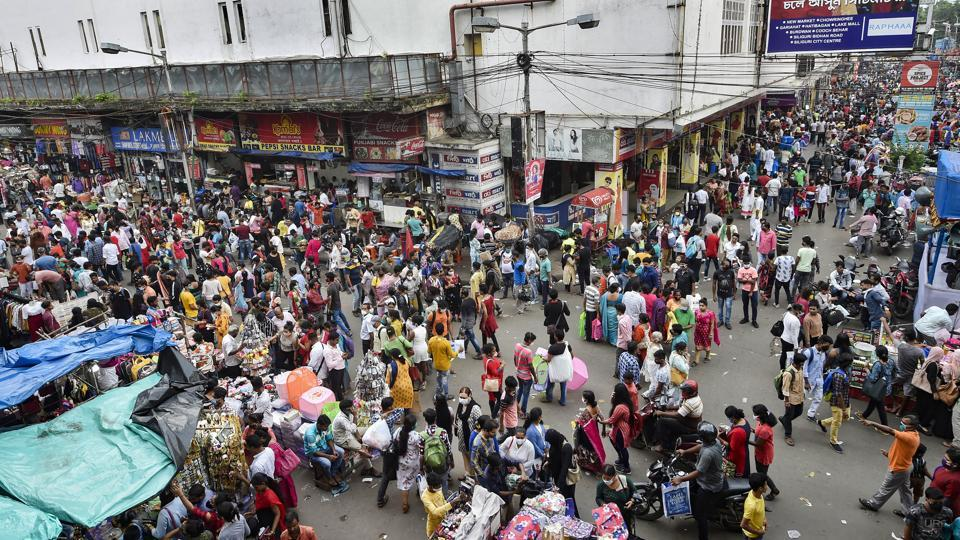 People throng a market for shopping ahead of Durga Puja festival, in Kolkata, earlier in October.