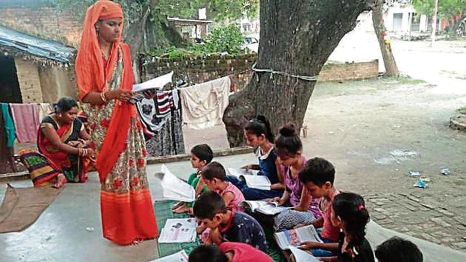People teaching needy students of government-run primary schools in their homes during the pandemic times