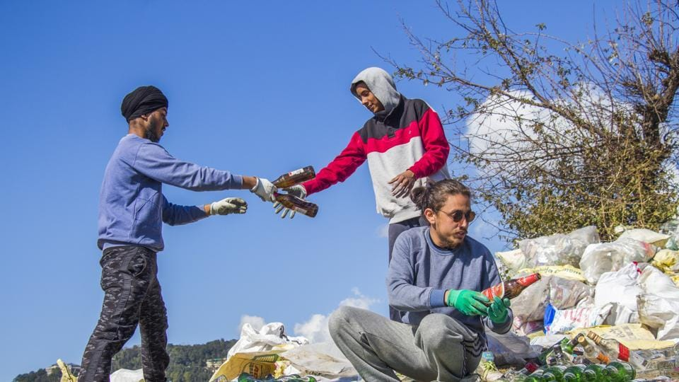 Volunteers segregate waste during a clean-up drive at Indrunag near Dharamshala.