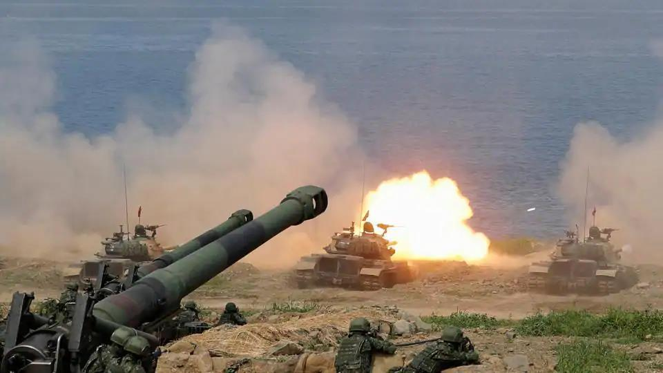 A CM-11 Brave Tiger tank fires during the live fire Han Kuang military exercise, which simulates China's People's Liberation Army (PLA) invading the island, in Pingtung, Taiwan  on May 30, 2019.