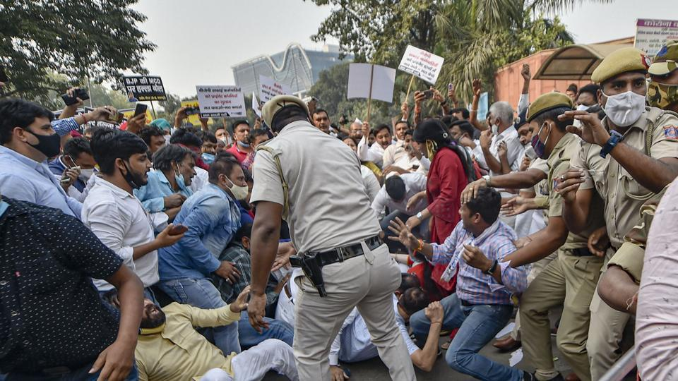 Police personnel detain AAP leaders and councilors during a protest against privatization of sanitation services by SDMC, at Civic Centre in New Delhi on Wednesday.