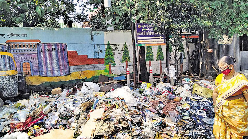 Garbage lying on street at Lohiyanagar in Pune, India, on Tuesday, October 27, 2020.