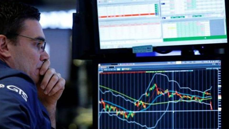A specialist trader works at his post on the floor of the New York Stock Exchange (NYSE) in New York, US.