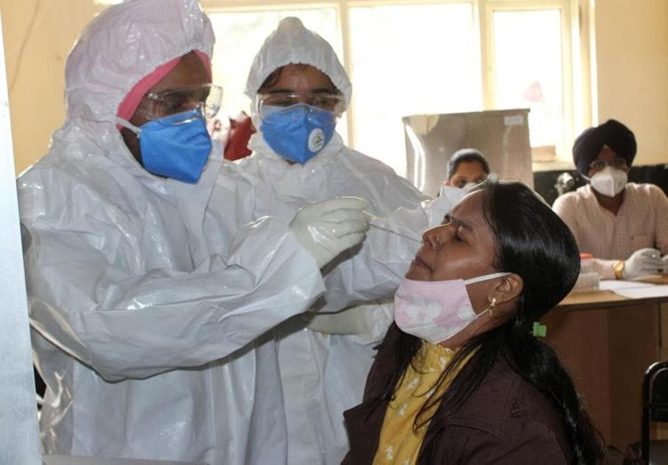 Health staff taking a sample from a patient for Covid testing at the civil hospital in Phase 6, Mohali, on Thursday.